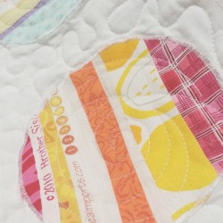 scrappy upcycled lap quilt